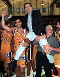 Limoges basketball team captain Richard Dacoury (L) lifts trainer Maljkovic , May 14th..